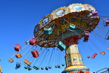 Colorful Carnival Ride At Amus...