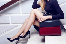 Model Close Up Legs In High Heel With Fashion Leather Red Bag