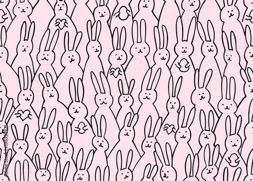 fototapeta na ścianę Funny bunny seamless pattern. Illustration of cute easter bunnies with easter eggs and hearts. Bright easter background for textile, fabric, covers, manufacturing, scrapbooking, wallpapers, print