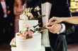canvas print picture - Bride and groom cut the wedding cake together