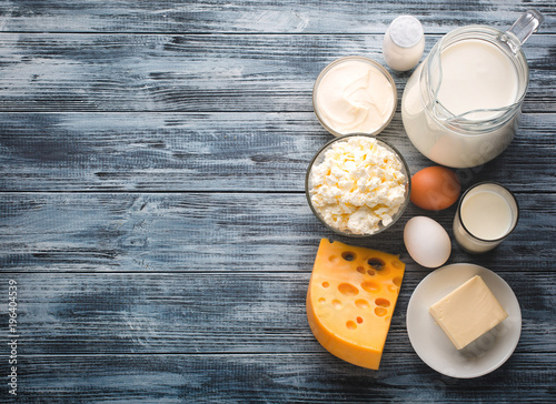 Poster Dairy products Dairy products grocery assortment on rustic wooden table. Top view.