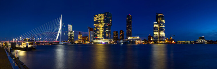 City Landscape, panorama - Night view on Erasmus Bridge and district Feijenoord city of Rotterdam, The Netherlands.