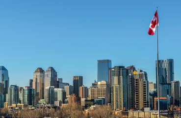 Calgary city skyline and pole with canadian flag