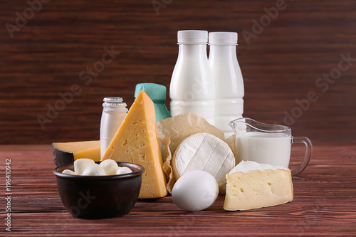 Printed kitchen splashbacks Dairy products Different dairy products and egg on wooden table