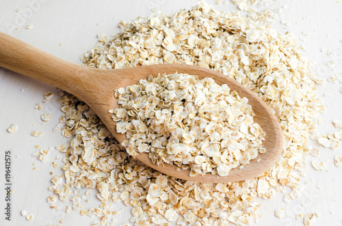 rolled oats in big spoon