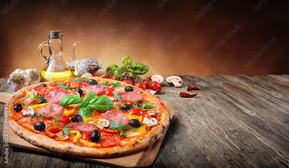 Hot Pizza Served On Old Table