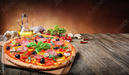 Fotografie, Obraz  Hot Pizza Served On Old Table