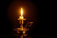 Burning Candle On Candlesticks