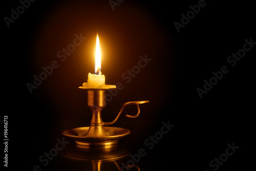 Burning candle on candlesticks Fototapete