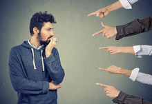 Anxious Man Judged By Different People. Concept Of Accusation Of Guilty Guy