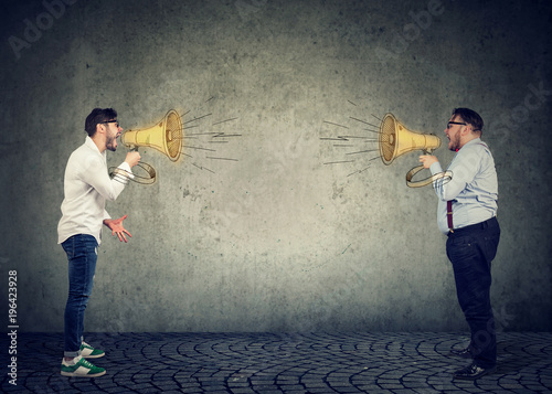 Photo Business men screaming into a megaphone at each other
