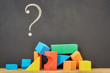 Question Mark And Plastic Building Blocks