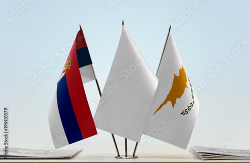 Flags of Serbia and Cyprus with a white flag in the middle