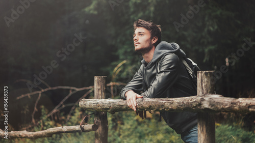 Foto op Canvas Ontspanning Young man hiking in the forest
