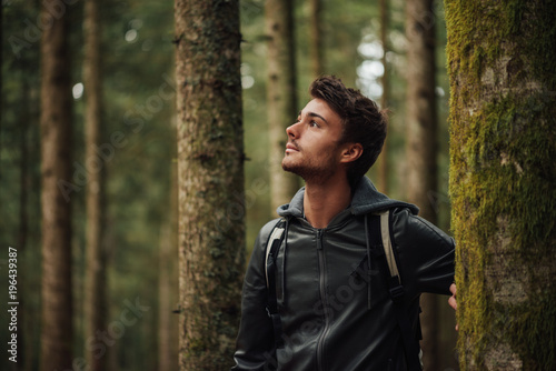 Young man exploring a forest - 196439387
