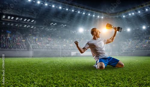 Fotografía  Soccer player at stadium. Mixed media