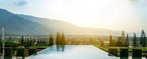 Fotografia  Outdoor luxury swimming pool at the holiday, background is beautiful mountain, relax place