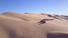 Dune Buggies And ATVs Race Across The Imperial Sand Dunes In California.