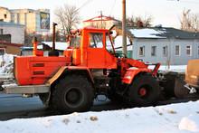 Bright Orange Excavator Tracto...