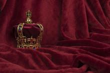 Royal Crown On A Red Velvet Ba...