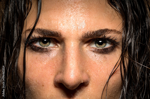 Poster  Expression in female athlete eyes showing focus, determination, conviction, powe