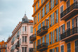 white and orange stucco buildings in a row