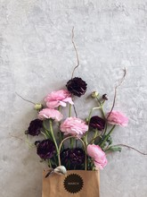 Ranunculus Flowers In A Paper Bag With A March Sticker