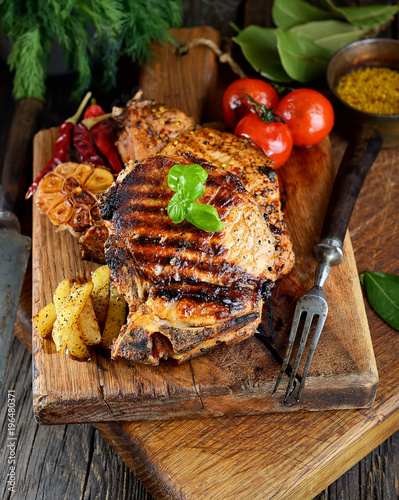 Fototapety, obrazy: Steak with herbs  on a wooden background