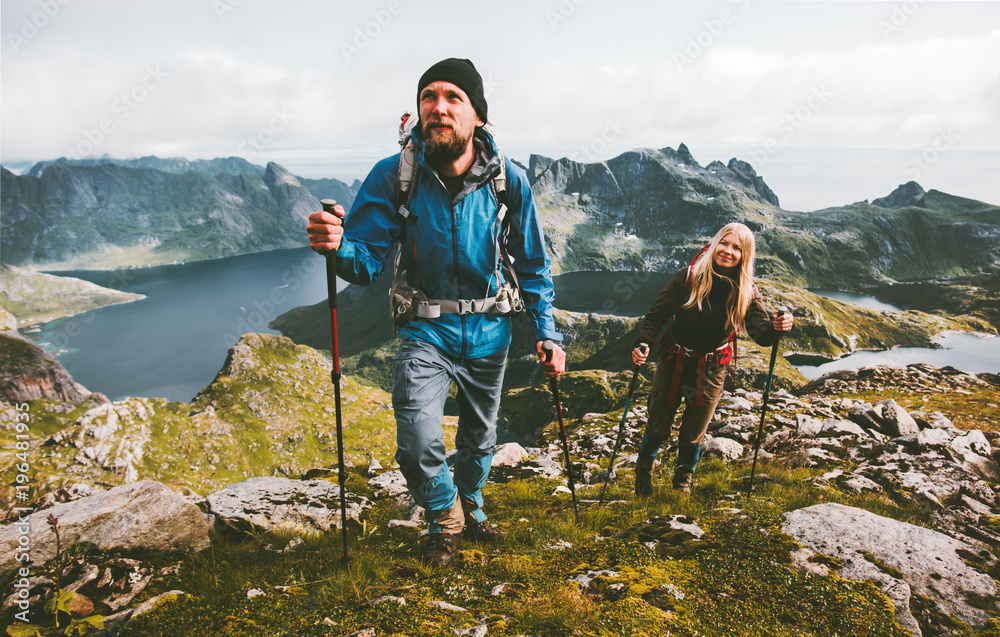 Obraz Couple travelers hiking in mountains family traveling together adventure lifestyle concept vacations outdoor fototapeta, plakat