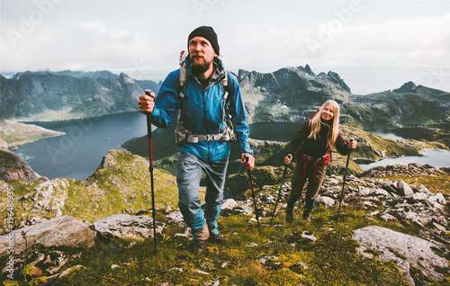 Fotografering Couple travelers hiking in mountains family traveling together adventure lifesty