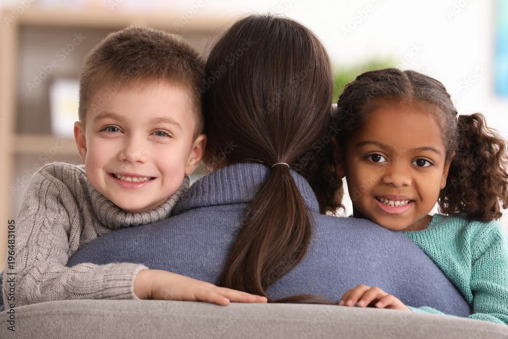 Fototapety, obrazy: Woman hugging little kids indoors. Child adoption