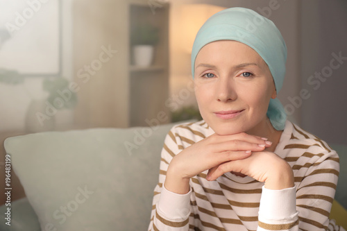 Young woman with cancer in headscarf indoors Canvas Print