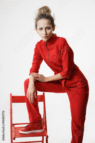 Valokuva  Provocative fashionable woman in red overall