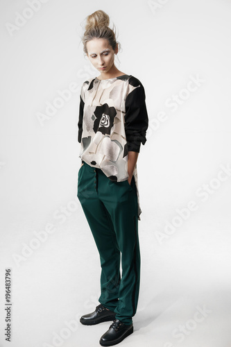 Valokuva  Stylish contemporary woman on white