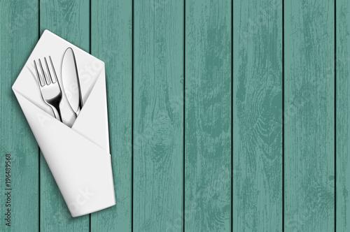 Fotografie, Obraz  Fork and knife in a white napkin