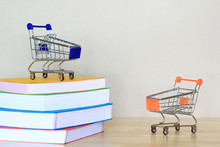 Model Miniature Cart With Books On White Background, Shopping And Education Concept