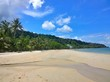 Blue sky and clouds over a tropical beach with green palm trees on Koh Chang island in Thailand