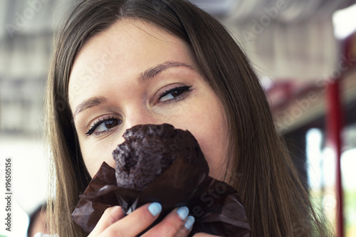 Woman holding sweet cupcake cake dessert, she wants to eat it Poster