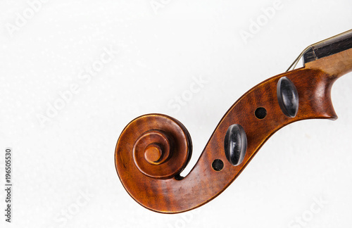 Obraz na plátne Closeup the construction of violin,Scroll,Pegbox and neck,at the right side,on white background