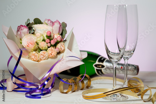 Beautiful Wedding Bouquet Of Pink Roses With A Bottle Of Champagne