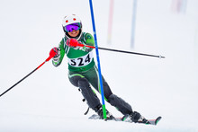 Skier At A Gate On The Slalom Race Course