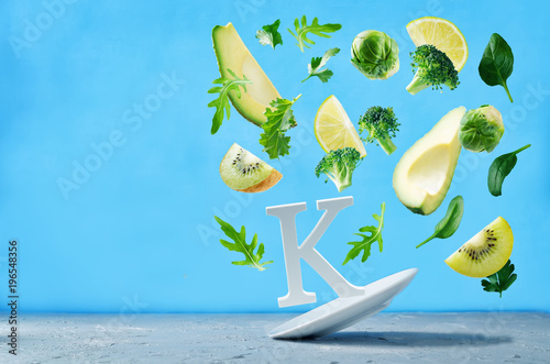 Fototapeta Flying foods rich in vitamin k. Green vegetables obraz