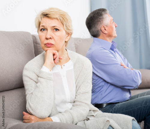 aggrieved middle-aged couple quarreling at home with each other Canvas Print