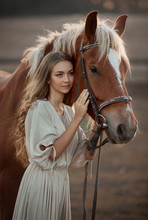 Girl With Horse At Sunset
