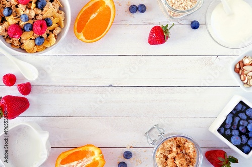 Fotografie, Obraz Ingredients for a healthy breakfast  forming a frame over a white wood background
