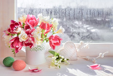 Pink Tulips And White Freesia Flowers With Easter Decorations On The Window Board