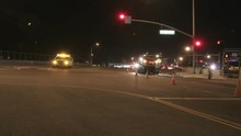 Traffic Passes Through An Intersection Where Construction Crews Are Working.
