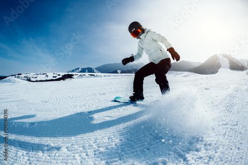 Foto op Canvas Wintersporten one snowboarder snowboarding in winter mountains