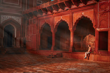 Young Guy Sitting Under The Rays Of The Morning Sun And Watching The Taj Mahal Mosque