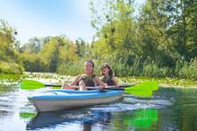 Family Kayaking, Mother And Da...